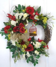 Spring Wreath with cute red birds and birdcage. For more wreaths, or to order a custom wreath go to www.hunguponwreaths.com