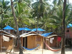 Picturesque Palolem Beach, enclosed by thick coconut palms, is south Goa's most popular beach. Plan your trip there with this travel guide. Goa Travel, Tropic Of Capricorn, Goa India, Beach Tops, Destin Beach, Great Barrier Reef, Plan Your Trip, Travel Essentials, Travel Guide