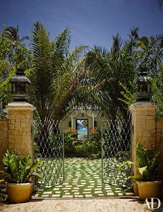 Metal gates mark the entrance to Playa Grande Beach Club, designer Celerie Kemble's compound in the Dominican Republic.