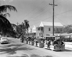 Conch tour train passing through a residential area - Key West, Florida