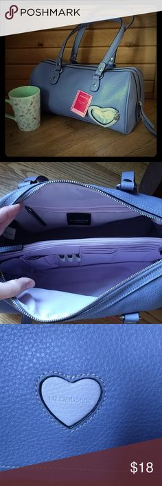 """L. Claiborne // Vegan """"Picture This"""" Handbag Pretty lilac purple, barrel-shaped handbag by Liz Claiborne Accessories. From the """"Picture This"""" line, it allows you to personalize your purse with a picture! (Inserts into heart on front.)  Multi-pocket, zippered organization inside. Cute branded """"Liz Claiborne"""" heart on bottom of bag. 13"""" wide x 7"""" high. Bag is vegan friendly - 100% polyvinyl chloride with100% polyester lining. Liz Claiborne Bags"""
