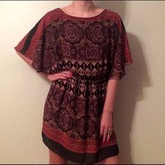 Medallion Print Dress Medallion Print Dress, elastic fitted waist, oversized flapper sleeves, skirt falls to mid-thigh, gently worn, no tag with brand or size, could fit a size small or medium Dresses