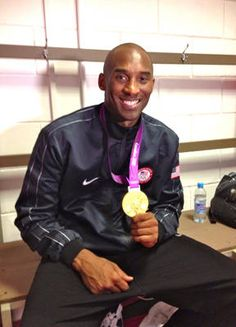 Kobe Bryant shows off his newest trophy after Team USA defeated Spain to win gold in men's basketball at the London Olympics.