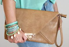 clutch brown, arm candy