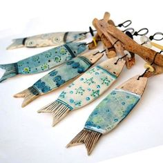 ceramic fish and driftwood hangers by Shirley Vauvelle available at… Fish Crafts, Beach Crafts, Clay Crafts, Ceramic Clay, Ceramic Pottery, Deco Marine, Clay Fish, Wood Fish, Driftwood Crafts