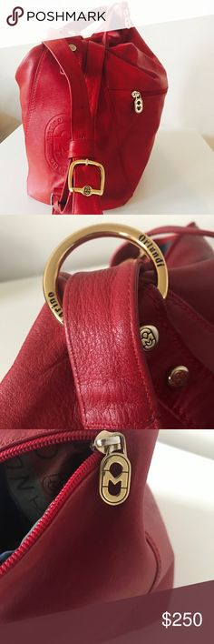Marino Orlandi Italian Leather Handbag Gorgeous red (rare) leather Marino Orlandi Italia purse. Luscious. Pockets inside and outside. Gorgeous gold hardware. Smooth high quality zipper top. Feet at the bottom. Leather feels supple & velvety. Leather & lining in perfect condition. Clean. Can be worn as a backpack. Very deep and roomy. Made in Italy. www.marinoorlandi.it check the website out! Marino Orlandi Bags Shoulder Bags