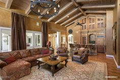 """Mediterranean Living Room with Veresque 5"""" x 47"""" x 8mm Maple Laminate in Chestnut Maple, FauxWood Beams Resawn Wood Beams"""