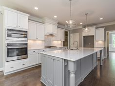 Horizon Custom Builders/White and gray kitchen, quartz countertops