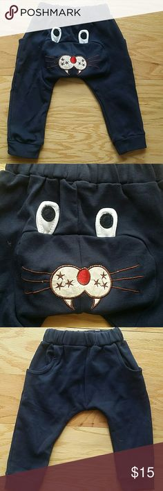 NWOT Navy Sweatpants Adorable design on the back of the pants :) Very cute item  This item is brand new and never used Bottoms Sweatpants & Joggers