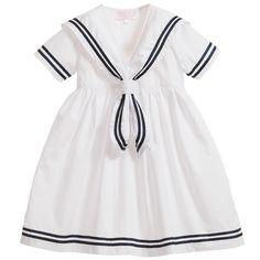Powell Craft girls white cotton short-sleeve'Emma' sailor dress with navy bluetrims on the sleeve, collar and hem. <ul> <li>100% cotton</li> <li>Machine wash at 30*C</li> </ul>