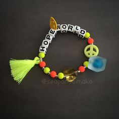 'CNS Hopeworld' J-Hope bracelet sold by SeaPanda Mako. Bts Bracelet, Pony Bead Bracelets, Bracelet Crafts, Cute Bracelets, Pony Beads, Bts Bag, Kpop Diy, Rainbow Aesthetic, Cute Jewelry