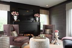 Grasscloth wallpaper brings textural contrast to the dark living room [Design: Lucy Interior Design] Fireplace Seating, Family Room Fireplace, Black Fireplace, Tv Fireplace, Fireplace Design, Linear Fireplace, Fireplace Ideas, Room Design Bedroom, Bedroom Seating