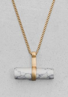 & OTHER STORIES Made from a brass blend, this necklace features a long chain with a genuine stone bar pendant.