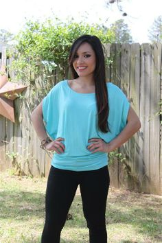 This short sleeve, batwing, semi tunic top has a  soft jersey feel, and a great figure flattering fit.