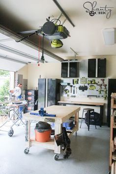 This Ryobi Tools Garage Door Opener is the BOMB! Bluetooth speaker, retractable extension cord, fans and so much more! Check it out at www.shanty-2-chic.com