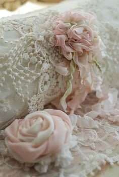 (via Shabby chic / Silk roses … a brooch on a pillow, lampshade, purse, or hat.)
