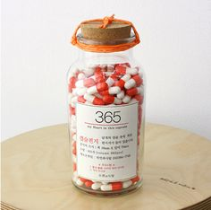 365 orange pill capsule letter bottle set on Etsy, $45.90