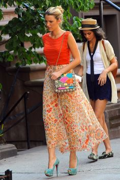 Blake Lively films a scene for Gossip Girl in an Alice + Olivia Mandy Chain Crop Top ($165), a Haute Hippie American Woman Circle Skirt ($425), Christian Louboutin Bollywoody Suede Pumps ($2,795) and an Angel Jackson Disco Rainbow Jai Bright Satchel.