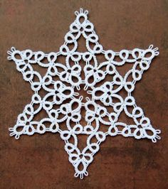 I just love this pattern. It looks like a perfect star. One more for the collection. Tatted in Milford Size 40 threads in white, this patte...