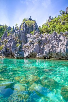 The ultimate activitywhen visiting El Nido, Philippines is to take island hopping tours to see the lagoons and coves in the area. We've compiled a list of our favorite spots to help you choose the best El Nido boat tour for you. | www.eatworktravel.com