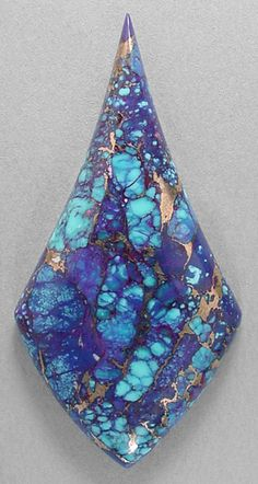 ~ Mohave turquoise ~  It is composed of small chunks of natural blue turquoise (some with fabulous spiderwebbing), to which they added purple dye and a brassy-bronze metallic.