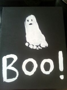our ghost Hallowen art. Babies foot print on canvas turned into ghost