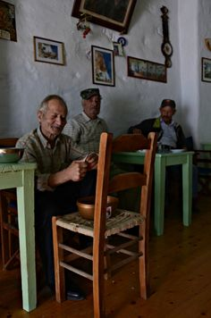 "Old Greek people passing their time at a ""kafenio"". 
