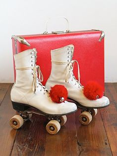 Vintage Rollerskates with Case... and they HAD TO HAVE the pom-poms.
