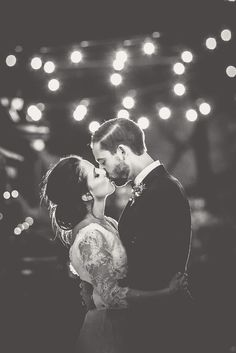 bride and groom photo under festoon lights