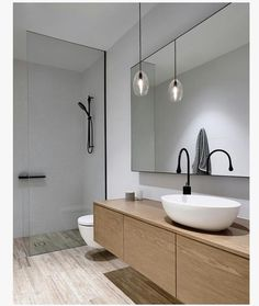 Contemporary bathrooms are all about minimalism. Although it might look expensive, this look is actually relatively easy to replicate on a budget.