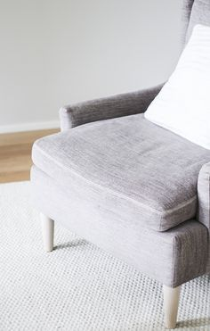 Linie Design Asko carpet off-white. Adea Hudson armchair. Via Coffee Table Diary blog
