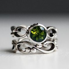 Peridot engagement ring set bezel solitaire by metalicious