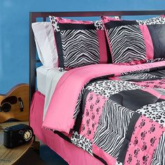 This bright pink comforter set is perfect for a girl's bedroom. The patchwork design features a black and white zebra print offset by swatches of hot pink. The set includes one full-sized comforter, bed skirt, and two standard pillow shams.