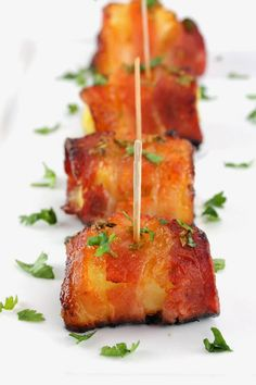 Sriracha Honey Glazed Bacon Wrapped Pineapple is a winning appetizer! Bacon is wrapped around pineapple and glazed with a sweet and smokey sriracha-honey sauce in this spectacular small bite.