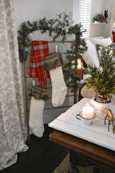 Holiday Housewalk Christmas at the cottage - Fox Hollow Cottage Home Tour - If you're pressed for space, or looking for a new idea, use and old wood linen drying rack to hang your stocking! I picked up a vintage one out junking and separated into two!