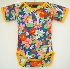 yellow and navy flower baby