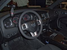 Interior view of Dodge Charger Pursuit police sedan. Console mount and lighting/siren controller shown are some of the Mopar equipment components available as installed factory options. Visit Crown's website for information on the 6 Mopar Equipment packages available, including many ala-carte items which can be ordered to provide a customized upfit package. http://www.1automotive-components.com/charger-pursuit.asp