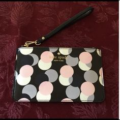 """Kate Spade Wristlet Kate Spade wristlet.  Interior is lined with Kate Spade fabric and adorned with a silver spade on one side. 6.5"""" x 4"""".  Comes with Kate Spade care card.  No Trades kate spade Bags Clutches & Wristlets"""