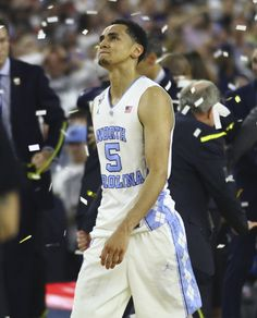 Senior Marcus Paige (5) walks off the court after a buzzer beater 77-74 loss to Villanova. Paige had made a three-pointer to briefly tie the game. Photo by Katie Williams / The Daily Tar Heel