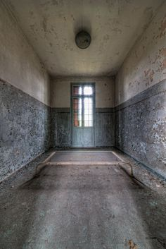 Manicomio V. (Italy) An abandoned psychiatric institution. One of the isolation cells... the bed is nailed to the floor...
