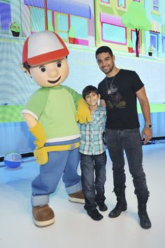 Wilmer Valderrama and his brother Christian pose with Handy Manny