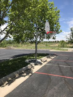 My kid's school designed their parking lot island curb around this portable basketball hoop.