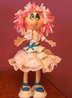 Moderna muñeca de comunión,