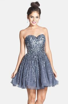 Free shipping and returns on Sherri Hill Embellished Silk Fit & Flare Dress at Nordstrom.com. Metallic sequins coat the sweetheart bodice of a twirl-ready party dress before shimmering down the short buoyant skirt. A richly jeweled waistband completes the glamorous silhouette.