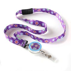 Our whimsical Starflower ribbon lanyard will add a burst of youthfulness to all of your workday outfits. Both the purple ribbon and the metal emblem which houses the retractable badge reel are decorated with a cheerful starflower pattern.