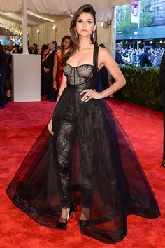 Nina Dobrev in a corseted top and tulle outfit by Monique Lhuillier.