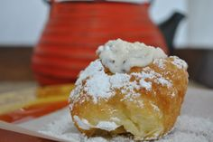 Sfingi (Sicilian Donuts/Fritters)..these are really good.. i only put powdered sugar on mine.. I'm married to a half Irish half Sicilian.. he likes these and can't get enough pasta fazool or cannoli's