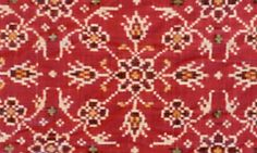 Ikat weaving - A floral motif on a Patan patola (India)