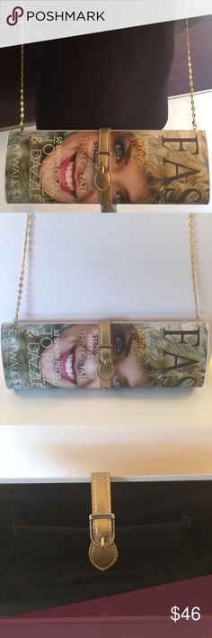 🎁SALE! VOGUE CLUTCH/ SHOULDER BAG VOGUE CLUTCH/SHOULDER BAG PURCHASED AND NEVER USED.  LOVELY COLORFUL BAG AND FULL OF FUN.  COMES WITH A LONG REMOVABLE CHAIN TO TAKE IT FROM A SHOULDER BAG TO A CLUTCH PURSE. THE BAG MEASURES 12 INCHES WIDE BY 4.5 INCHES TALL AND 2 INCHES DEEP. Bags Clutches & Wristlets