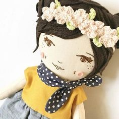 """This 17 inch heirloom doll is handmade with dark brown hair. You can choose to have her braided buns up, down or no buns for a pixie look. Please let me know in the notes section at check out. She comes with lovely details such as her hand embroidered face, an attached """"necklace"""","""